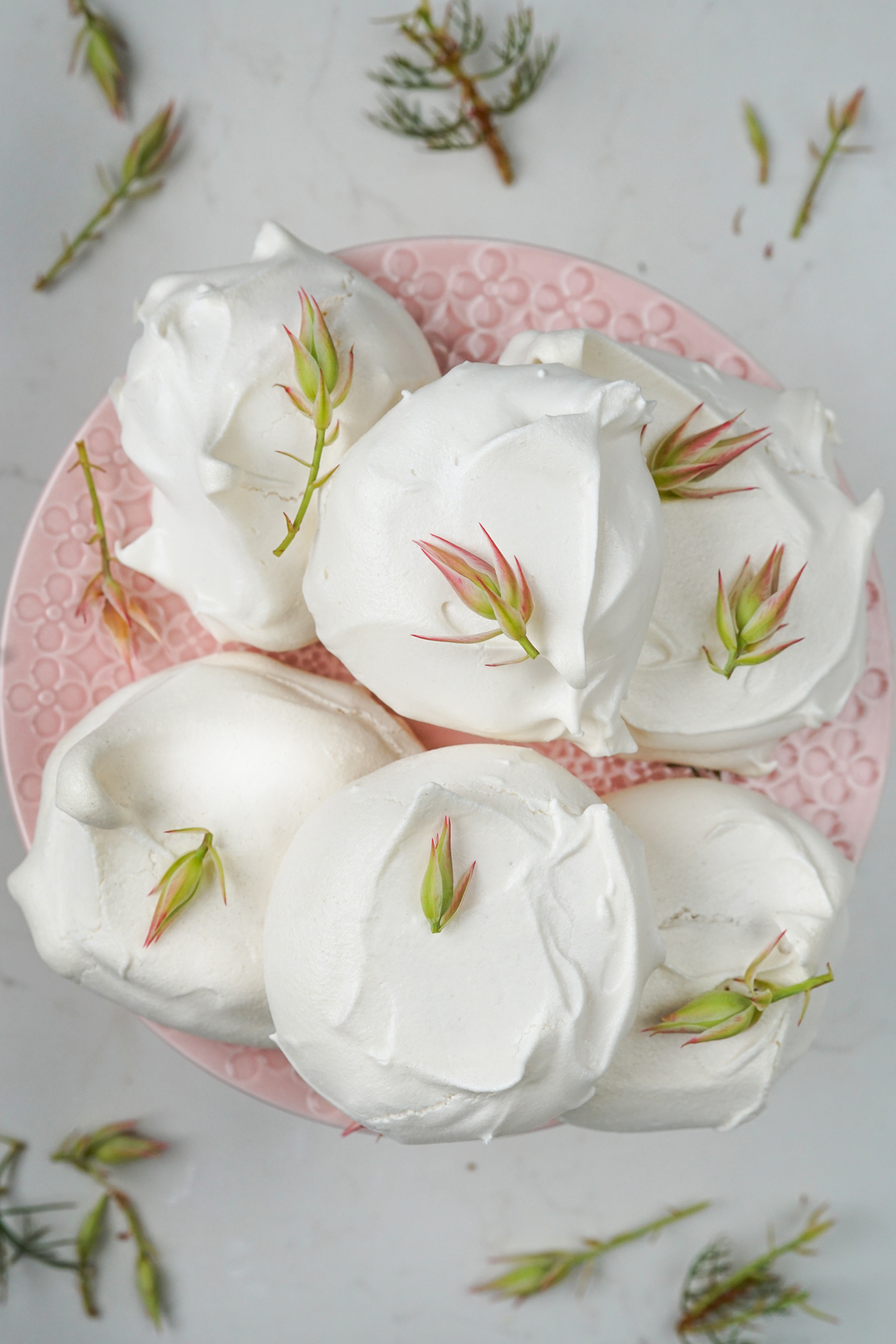 rustic meringues on pink cake stand with flowers